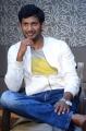 Telugu Actor Vishal Krishna Images @ Okkadochadu Promotions