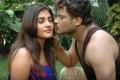 Vikram, Kausha in 6th Sense Movie Stills