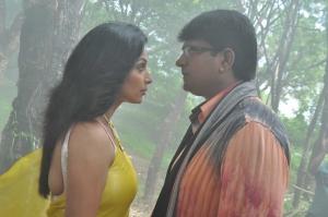 Ravi Babu, Asha Saini in Aakasam Lo Sagam Movie Stills