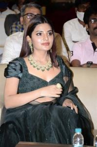 Actress Aathmika Green Dress Pictures @ Kodiyil Oruvan Pre Release