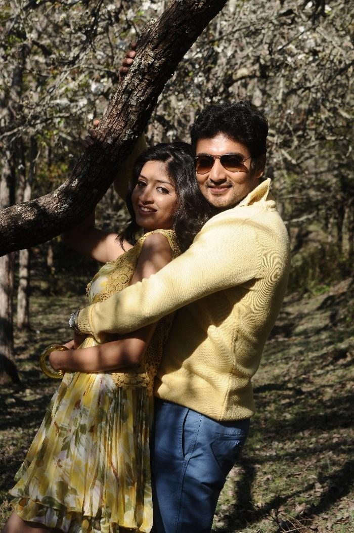 Poonam Kaur, Munna in Acharam Tamil Movie Stills