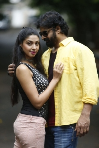 Angana Roy, John in Adrushyam Movie Stills