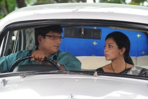 Ravi Babu, Asha Sani in Akasamlo Sagam Movie Stills