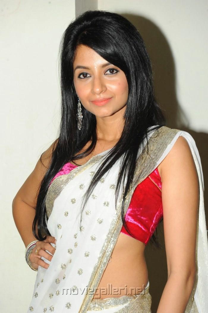 Amrutha Hot in Saree Photo Shoot Stills