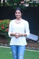Actress Rakshita Cute Photos in White Top & Blue Fade Jeans