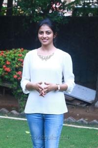 Actress Rakshita Cute Photos in White Top & Blue Fade Jeans
