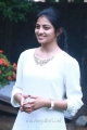 Actress Anandhi Cute Photos in White Top & Blue Fade Jeans