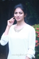 Chandiveeran Actress Anandhi Cute Photos in White Top & Blue Fade Jeans
