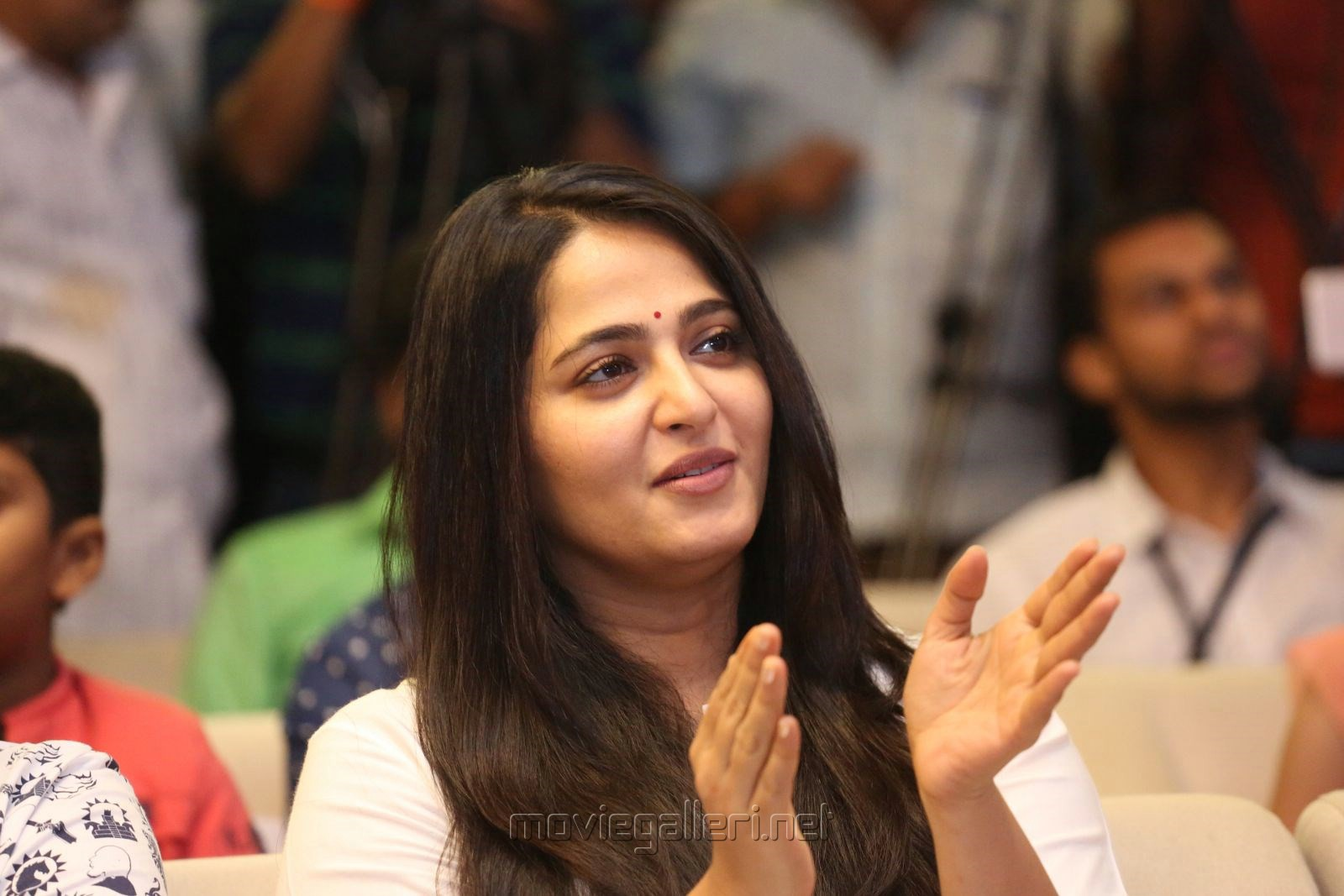 Actress Anushka Cute Smiling Photos @ The World of Baahubali Press Meet