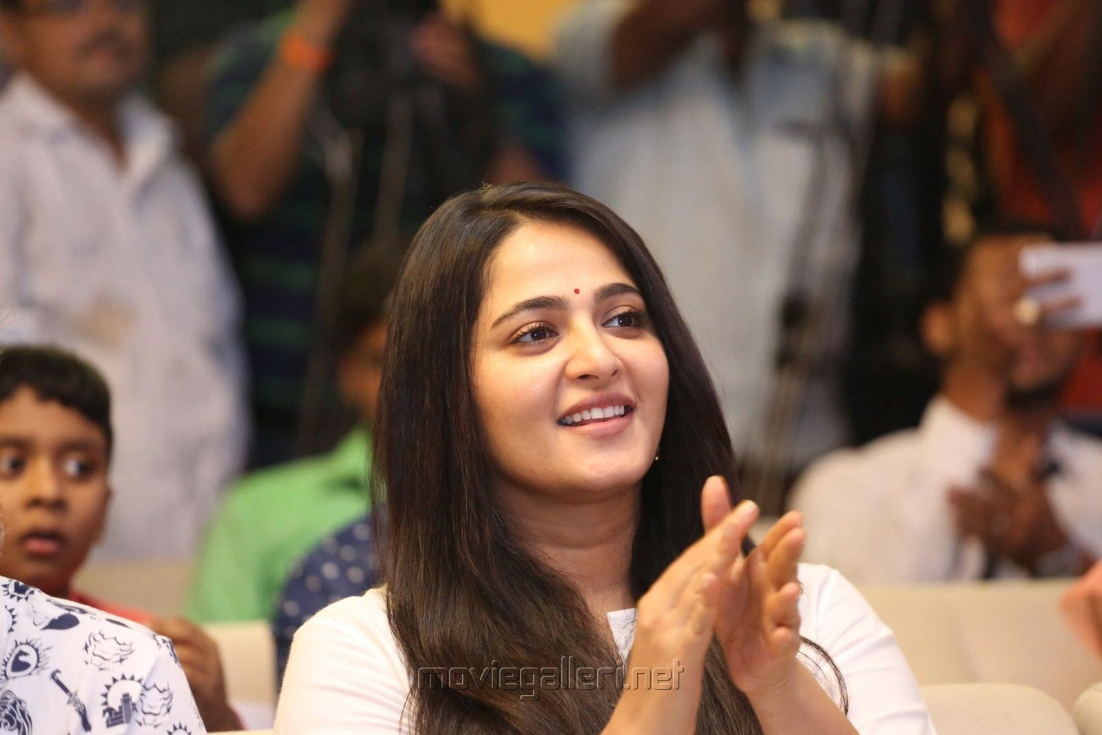Actress Anushka Shetty Cute Smiling Photos @ The World of Baahubali Press Meet