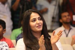 Actress Anushka Cute Smiling Photos @ The World of Baahubali Press Meet