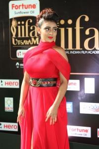 Actress Apoorva Red Dress Stills at IIFA Utsavam 2017 (Day 1) Green Carpet