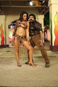 T.Rajendar, Mumaith Khan in Arya Surya Movie Stills