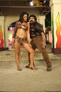 T.Rajendar, Mumaith Khan in Arya Surya Tamil Movie Stills