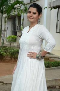 Actress Ashima Narwal White Dress Photos @ Sakala Gunabhi Rama Press Meet