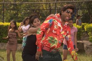 Vennela Kishore, Priyanka Chhabra in Athadu Aame O Scooter Movie Latest Stills