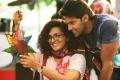 Parvathy, Arya in Bangalore Naatkal Tamil Movie Stills
