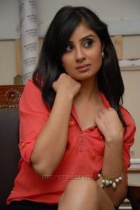 Bhanu Sree Mehra Hot Images in Red Shirt & Black Skirt