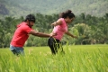 Actor Vignesh, Actress Divya Nagesh in Bhuvana Kaadu Movie Stills