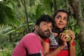 Vignesh, Divya Nagesh in Bhuvanakkadu Tamil Movie Stills