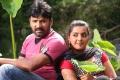 Vignesh, Divya Nagesh in Bhuvanakaadu Movie Stills