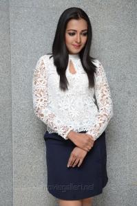 Catherine Tresa in White Top & Business Skirt