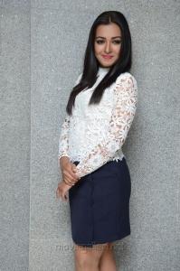 Katherine Teresa in White Top & Business Skirt