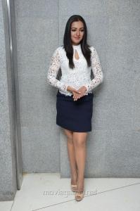 Catherine Tresa in White Top & Blue Skirt