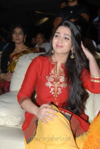 Charmi Kaur in Red Dress at Srimannarayana Triple Platinum Disc Function