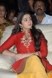 Charmi in Red Dress at Srimannarayana Triple Platinum Disc Function