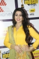 Actress Charmi Kaur Photos in Yellow Dress