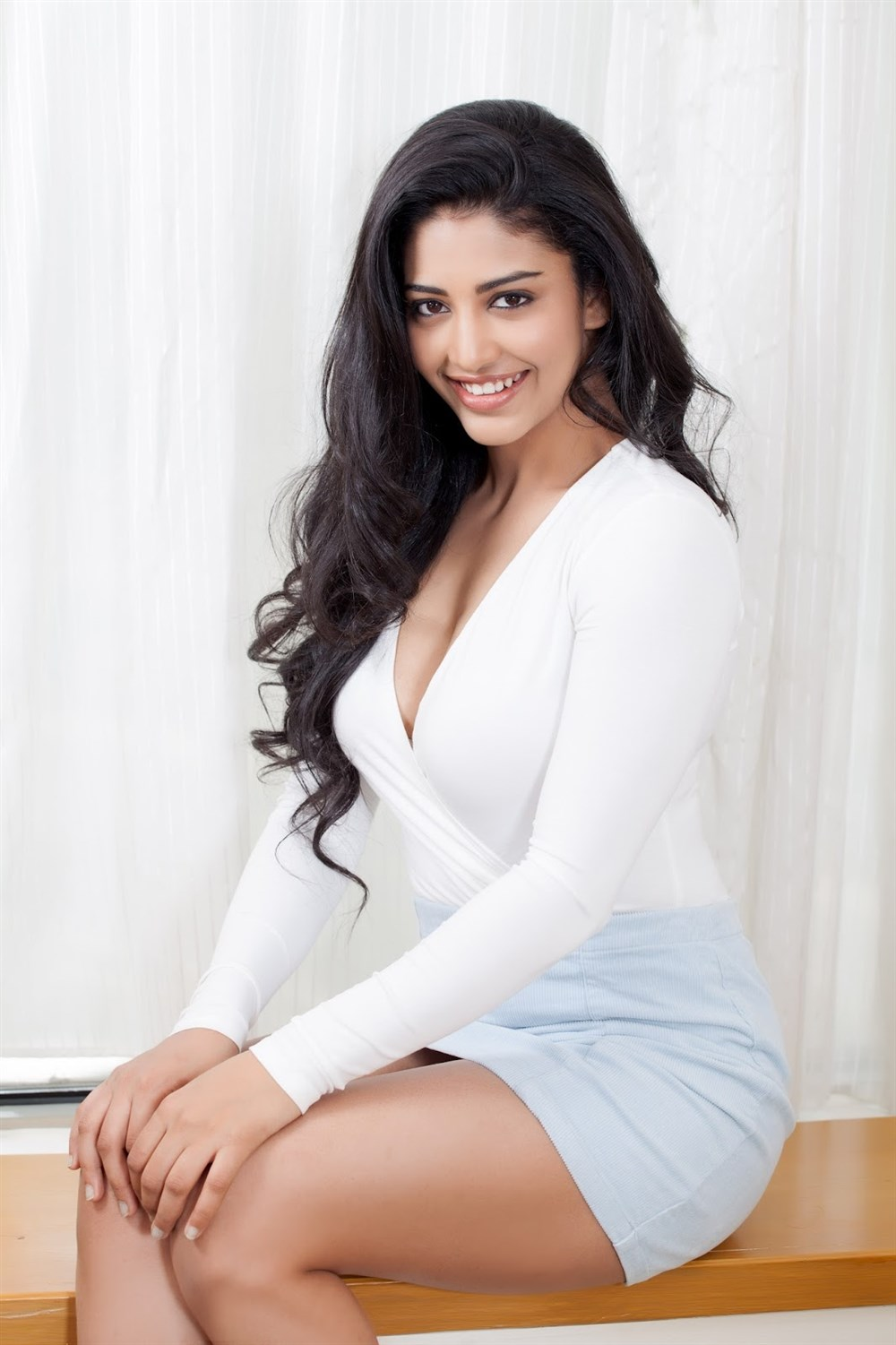 Telugu Actress Daksha Nagarkar in White Dress Glam Photos