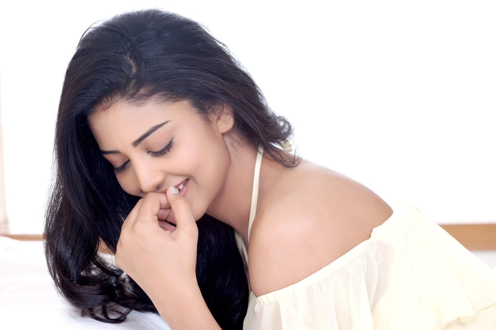 Actress Daksha Nagarkar Glam Photos in White Dress