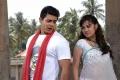 Raghu Mukherjee, Priyanka Kothari in Dandupalya Telugu Movie Stills