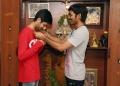 Dhanush Gifted Gold Chain to Anirudh For Maari Movie Team Stills