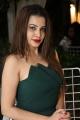 Actress Diksha Panth Hot Images in Green Mini Frock