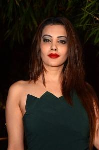 Actress Diksha Panth Hot in Green Mini Frock Images