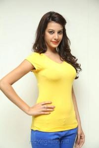 Actress Deeksha Panth in Light Yellow Top & Blue Pant