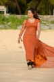 Actress Esthar Hot Pictures in Moderate Orange Color Dress