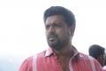 KS Thangasamy in Ettuthikkum Madhayaanai Movie Stills