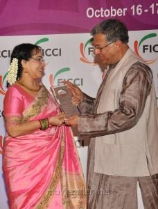 The Award to Ms Sheela was Given by Mr. Girish Karnad at FICCI MEBC 2012