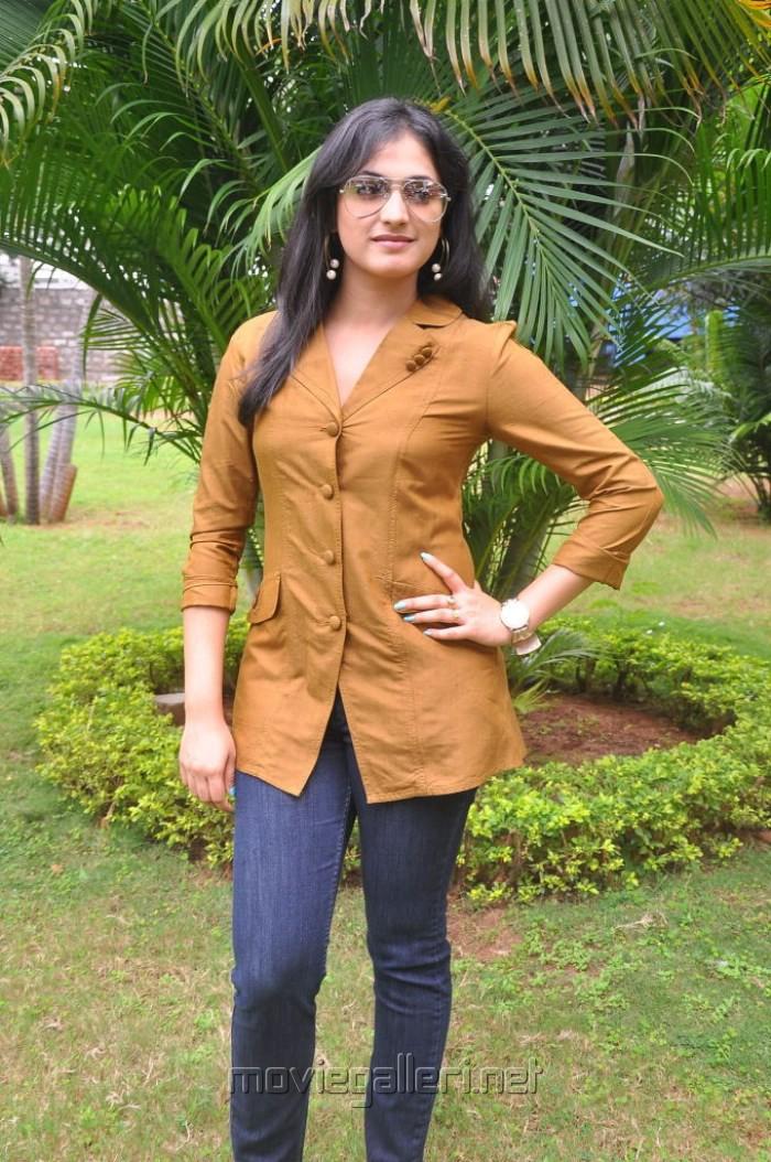 Telugu Actress Haripriya Photos in Orange Top & Blue Jeans