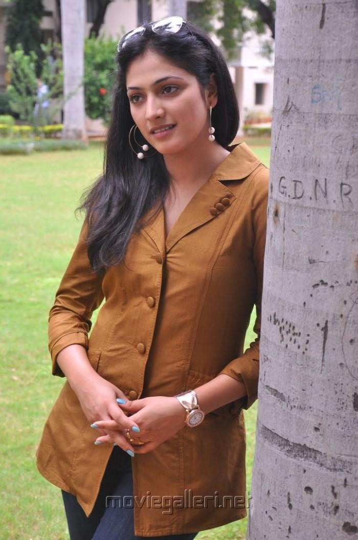 Actress Haripriya in Orange Top & Blue Jeans Photos