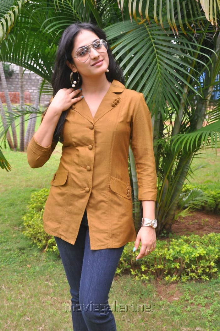 Haripriya New Photos in Orange Top & Blue Jeans