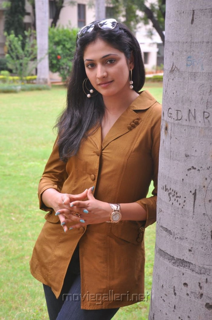 Haripriya New Photos in Orange Top & Blue Jeans