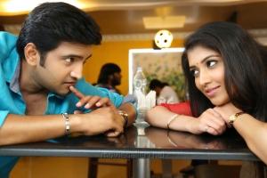 Santhanam, Akila Kishore in Inimey Ippadithaan Movie Stills