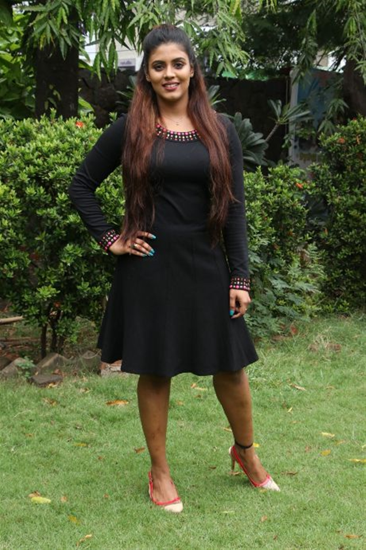 Actress Iniya Black Dress Pics @ Pottu Movie Press Meet