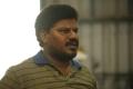 Actor Aadukalam Murugadoss in Iravukku Aayiram Kangal Movie Stills