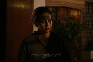 Actress Lakshmy Ramakrishnan in Iravukku Aayiram Kangal Movie Stills