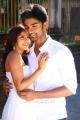 Priya Anand, Atharva in Irumbu Kuthirai Movie Stills